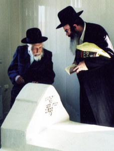 Reb Michel Dorfman and Rabbi Nasan Maimon at the gravesite of Rav Nasan of Nemirov, Breslov, 2004.
